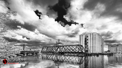street bridge abandoned water wisconsin architecture clouds canon river landscape downtown waves cityscape place unitedstates streetphotography milwaukee thirdward mke architecturalphotography milwaukeeriver 3rdward milwaukeewi discoverwisconsin travelwisconsin 5dmarkiii andrewslaterphotography