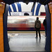 Waiting for train - orange walls - South Kensington by Luke Agbaimoni (last rounds)