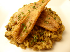 Fried perch fillets and porcini risotto