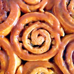 produce(0.0), pretzel(0.0), baked goods(1.0), cinnamon roll(1.0), food(1.0), dish(1.0), cuisine(1.0), snack food(1.0),