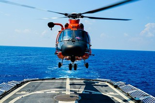 A Coast Guard helicopter from the Coast Guard Helicopter Interdiction Tactical Squadron in Jacksonville, Fla., lands aboard Coast Guard Cutter Reliance during operations in the Caribbean Sea. The helicopter and cutter crews worked together in detecting and interdicting suspected smugglers in the Western Caribbean. (U.S. Coast Guard photo by Petty Officer 2nd Class Joseph Gagnon)
