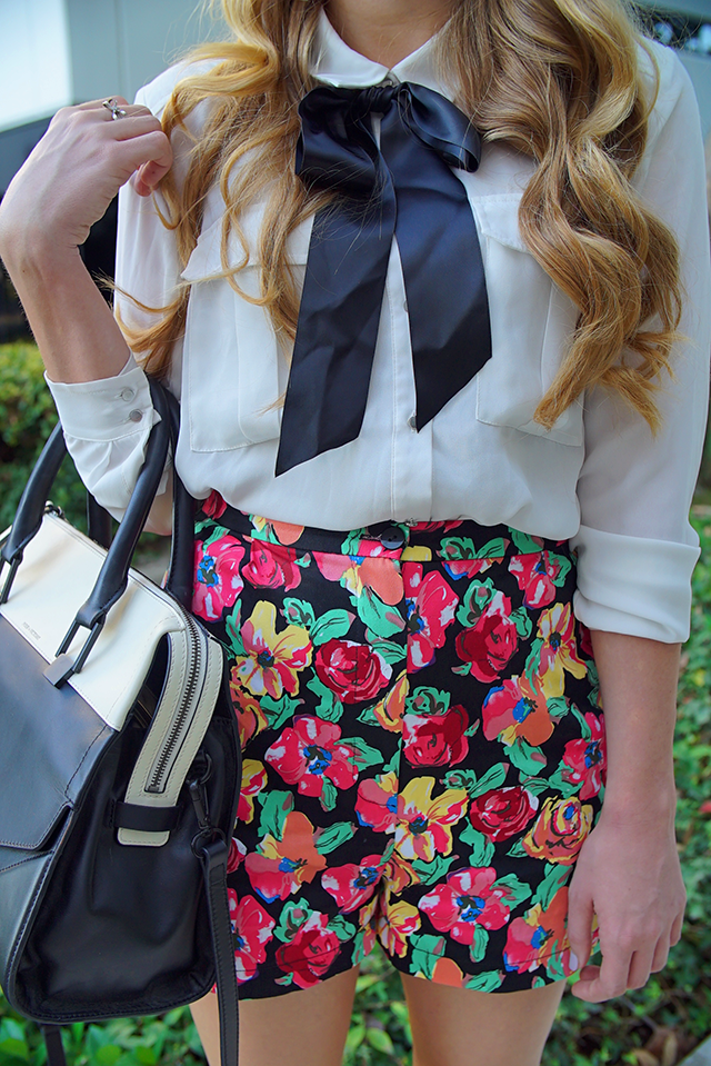 tie-neck blouse and floral shorts