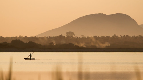 africa people sun nature weather sunrise boat canoe malawi transportation watercraft centralregion kamuzudamii