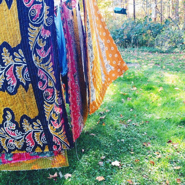 Kantha quilts on the clothesline.