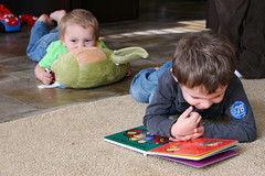 infant(0.0), crawling(0.0), sitting(0.0), child(1.0), play(1.0), reading(1.0), person(1.0), toddler(1.0), learning(1.0),