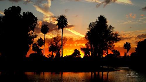 sunset golfcourse waterhazard suncity sigma18250mm canoneos70d suncitycountryclub cloudsstormssunsetssunrises cloudsstormssunrisessunsets