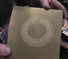 Geometric lathe pattern on metal