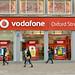 Vodafone mobile phone shop in Oxford Street, London, UK.