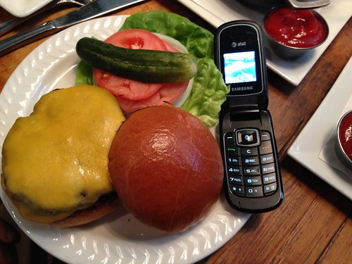Missys Brother's burger and his tiny flip phone