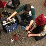 Max and Emily of Peer Corps making an electric go kart