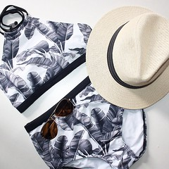 flatlay featuring milk and honey bikini, dotti hat and rayban sunglasses