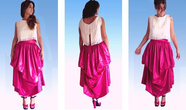 Conjunto falda fucsia y top flecos