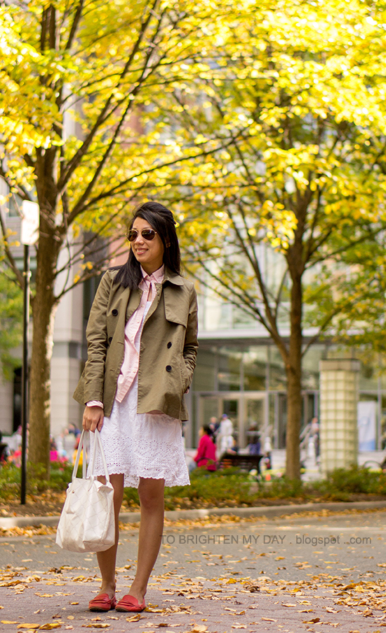 green swing trench jacket, pink striped button up shirt, white eyelet dress, red loafers