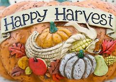 happy harvest words on a pumpkin craft