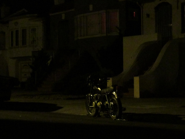 parked motorcycle at 26th avenue between Lincoln and Irving, night; The Sunset, San Francisco (2014)