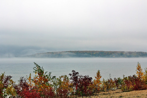 autumn red orange mist lake color green water weather yellow fog island october fallcolor michigan shoreline mackinacisland lakehuron drizzle autumncolor roundisland northernmichigan lowerpeninsula jannagalski janangal