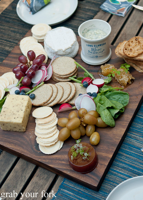 Anna's cheese board with John's smoked grapes