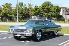 cadillac(0.0), cadillac calais(0.0), full-size car(0.0), automobile(1.0), automotive exterior(1.0), vehicle(1.0), performance car(1.0), cadillac coupe de ville(1.0), cadillac eldorado(1.0), antique car(1.0), sedan(1.0), land vehicle(1.0), luxury vehicle(1.0), coupã©(1.0),