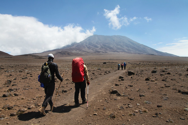 Liam and senior guide Charlie make their way across the saddle (Moshi, Tanzania)