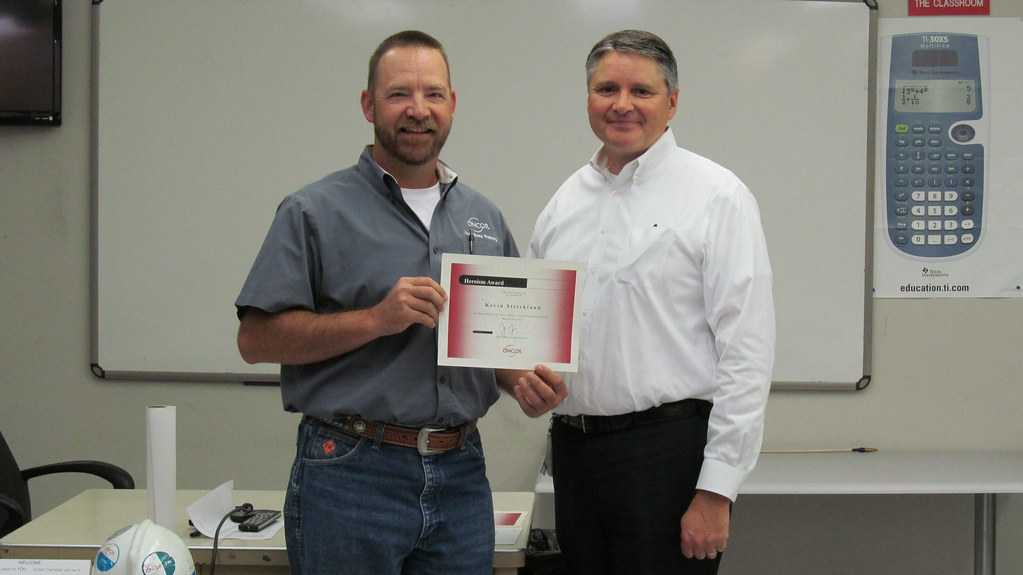 Kevin Strickland accepts Safety Heroism Award from COO Jim Greer