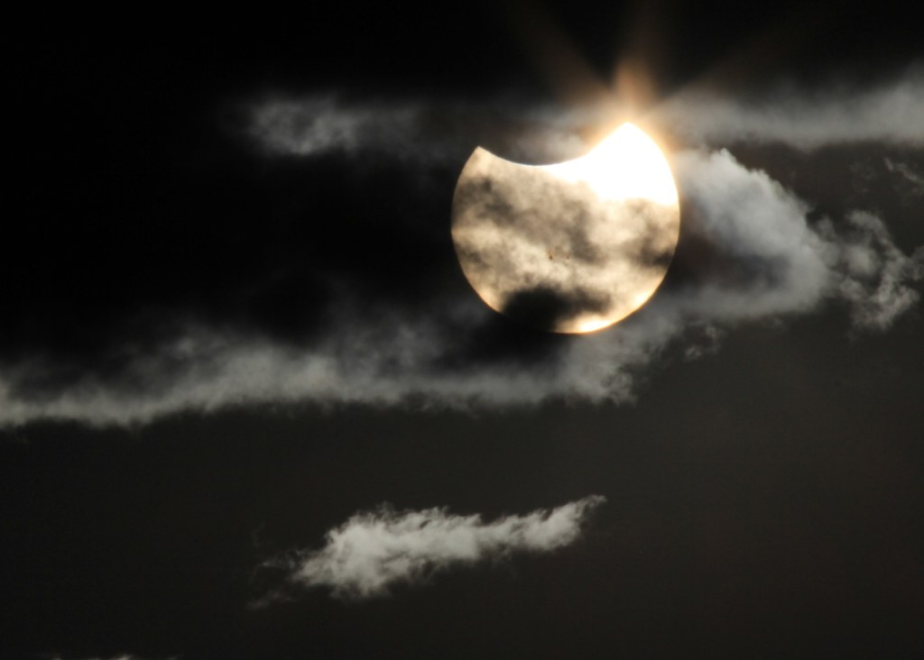 Partial Solar eclipse with sunspots barely showing