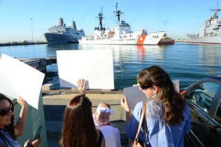 Families wait for the Coast Guard Cutter Sherman to finish pulling into homeport to be reunited with their loved ones during a homecoming celebration for the San Diego-based cutter at Naval Base San Diego, Oct. 24, 2014. The Sherman crew returned home after a 52-day deployment to the Eastern Pacific Ocean participating in UNITAS 2014 and conducting counter maritime drug interdiction operations. (U.S. Coast Guard photo by Petty Officer 2nd Class Connie Terrell)