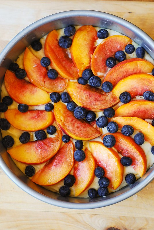 arranging the fruit on top of the cake
