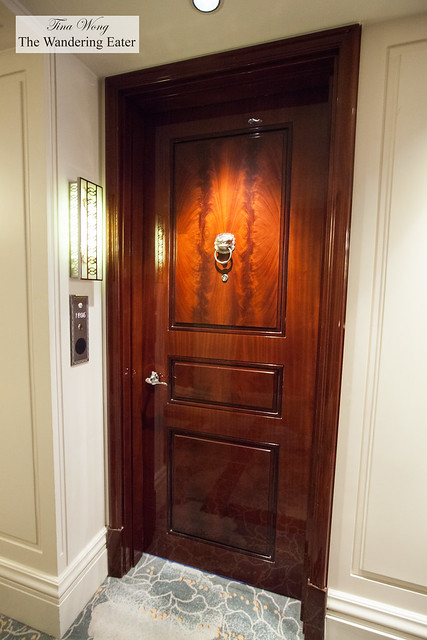 A handsome, stately door to the suite