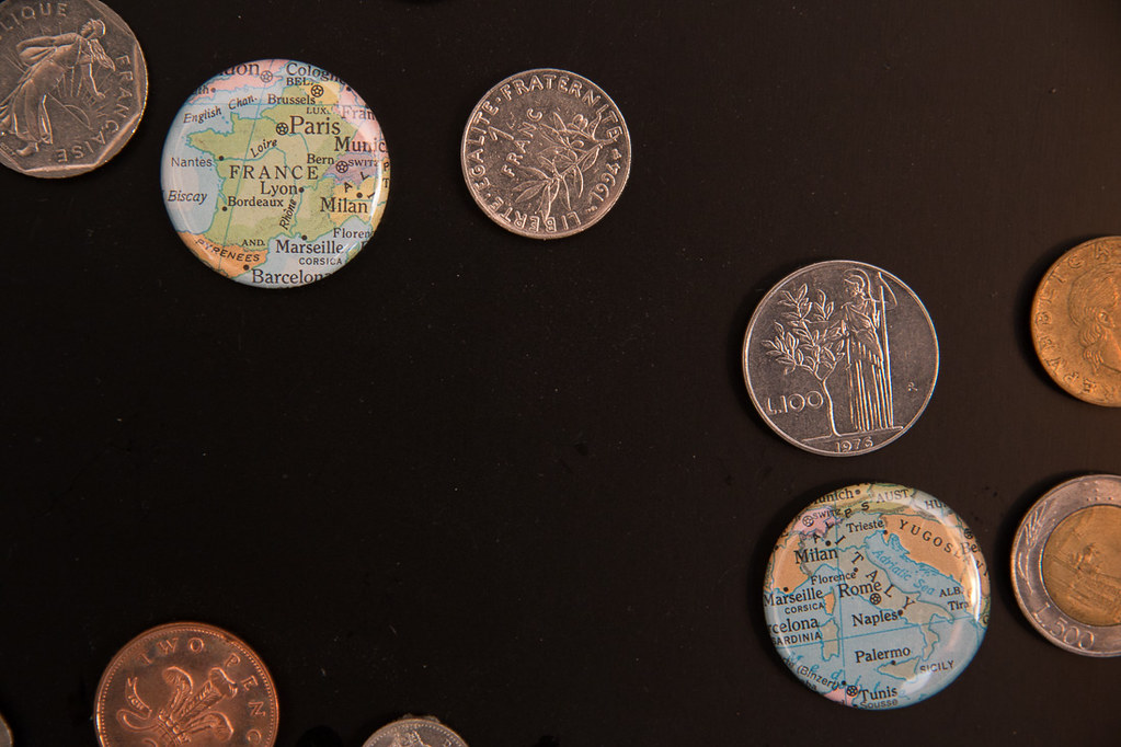 Closeup of foreign coin display and map magnets