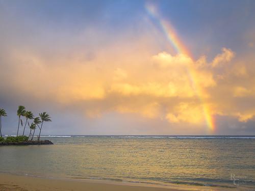 20mmf17panasonic em5 hi hawaii honolulu kahala omd oahu olympus pacificocean beach clouds evening landscape ocean palmtree rainbow sand seascape sunset surf trees water waves