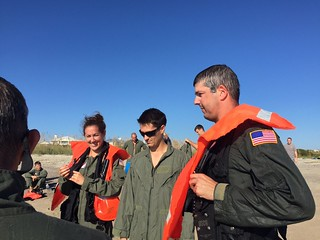 Personnel from Coast Guard Air Station Savannah, in Savannah, Ga., practice water survival techniques Wednesday, Oct. 1, 2014, during a training session. Throughout the training, the entire unit participated in learning the proper use of visual distress signals as well as participating in water survival while dressed in flight suits. (U.S. Coast Guard photo)