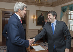 U.S. Secretary of State John Kerry greets Mark Lippert before swearing him in as the new U.S. Ambassador to the Republic of Korea, at the U.S. Department of State in Washington, D.C., on October 24, 2014. [State Department photo/ Public Domain]