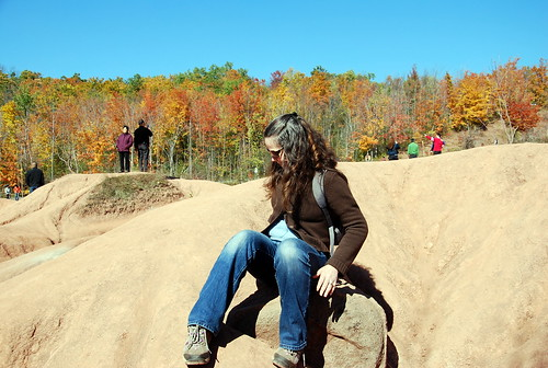 Sitting on eroded rock in the Cheltenham Badlands