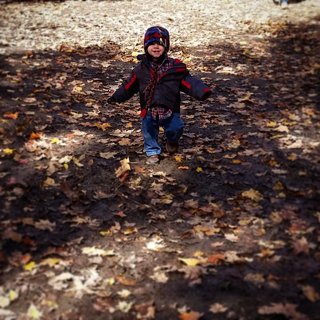 Very happy and muddy toddler running down a hill in the woods. #stevensonpartyoffive #pattersons #fall