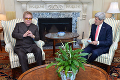 U.S. Secretary of State John Kerry meets with Sir Elton John to discuss PEPFAR and the work of the Elton John AIDS Foundation at the U.S. Department of State in Washington, D.C., on October 24, 2014. [State Department photo/ Public Domain]