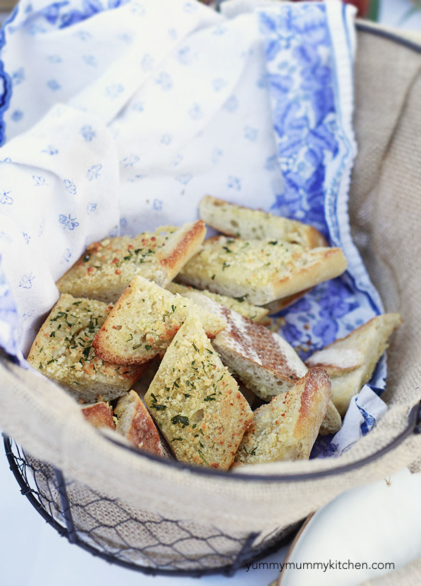 A basket is filled with slices of homemade garlic bread. The best easy garlic bread recipe.