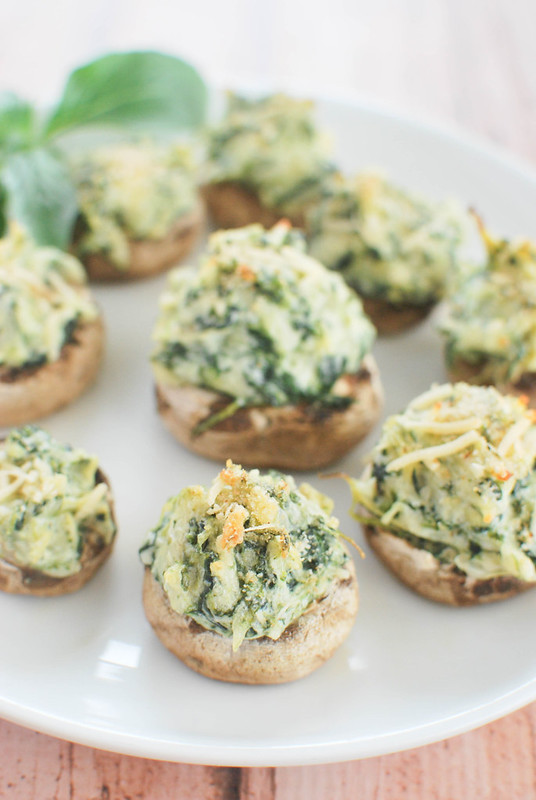 Spinach and Artichoke Stuffed Mushrooms - mushrooms stuffed with spinach and artichoke dip and topped with crunchy breadcrumbs!