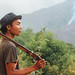 Laotian Hunter Scouting Hillside, Laos by AdamCohn