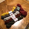 I was actually able to BUY yarn at a fiber festival this time, you guys! Surreal. Being outside a booth has its advantages. All lovely rustics today; Elemental Affects' Shetland Fingering in five different colors, and one skein of Feederbrook Farms' Flock