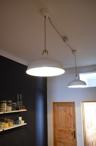Berlin apartment_ kitchen RANARP Ikea white pendant lights with black wall and shelves