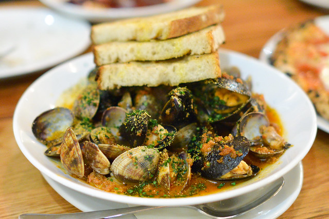Mussels & Clams. housemade spicy 'nduja sausage. fennel seed. preserved orange. grilled bread.