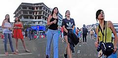 Macedonia Kavala harborfront girls in afternoon attitudes Greece