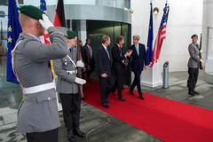 German National Security Adviser Christoph Heusgen escorts U.S. Secretary of State John Kerry and U.S. Ambassador to Germany John Emerson as they leave the Chancellery in Berlin, Germany, on October 22, 2014, following a bilateral meeting with German Chancellor Angela Merkel. [State Department photo/ Public Domain]