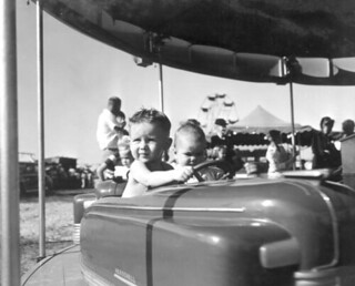 Young boys on amusement ride at Quincy's Tobacco Festival - Quincy