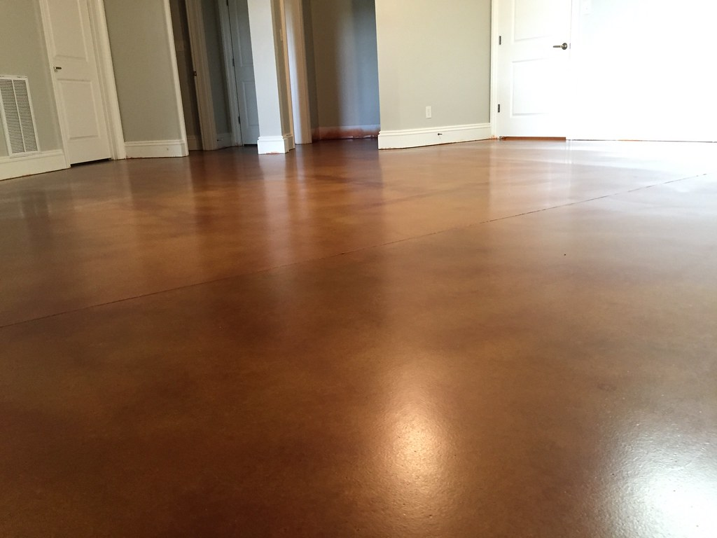 Stained Concrete Basement In Our New Low Gloss Urethane Sealer.