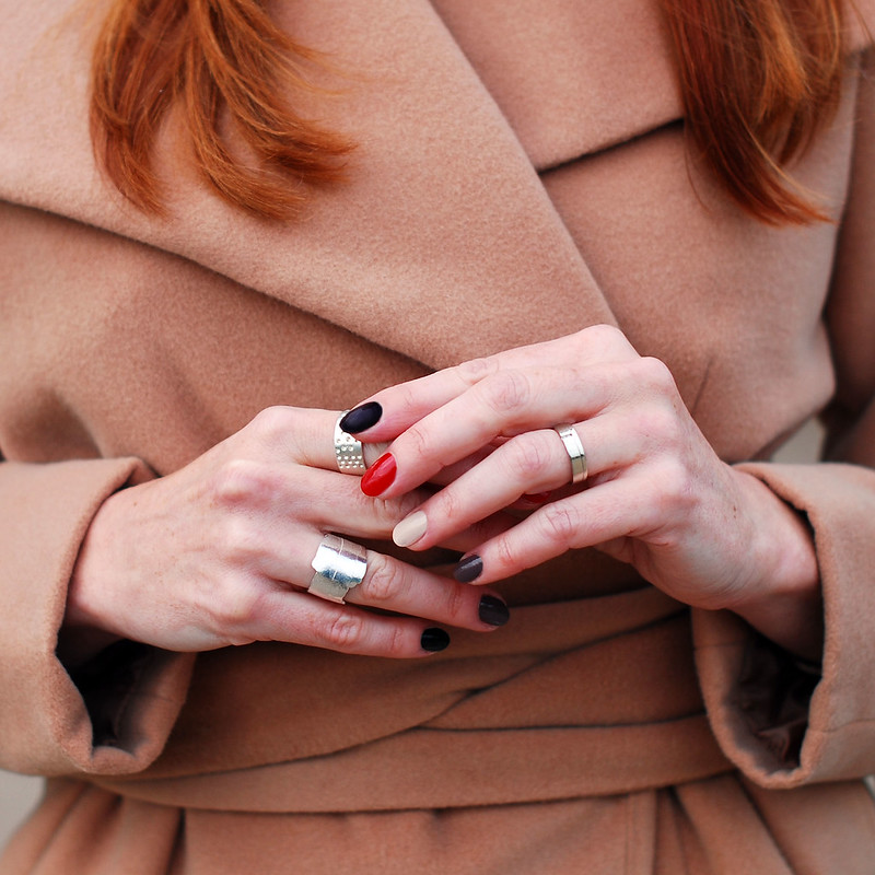 Camel coat, silver rings, autumnal manicure