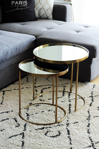 grey-couch-moroccan-rug-gold-coffee-table