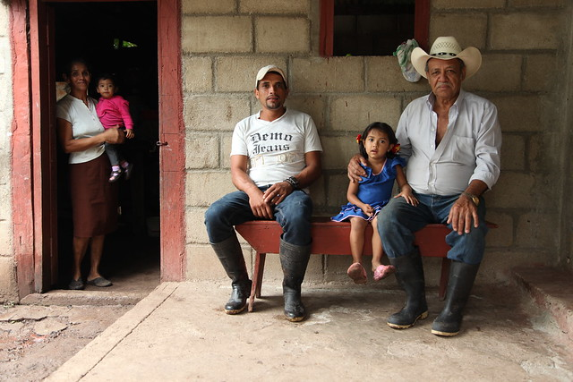 Rodolfo and three generations of his family, on his parents' porch