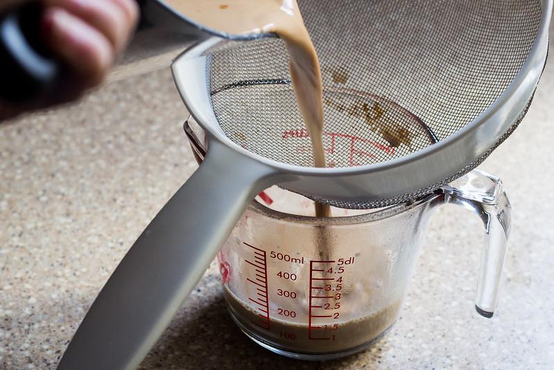 straining chai