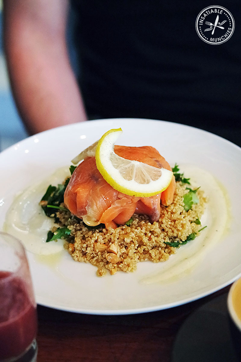 smoked trout, avocado and poached egg parcel with organic quinoa, herb and nut salad